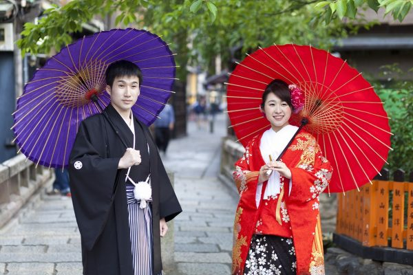 Kyoto,Japan- May 24,2016:Japanese couple in traditional cloths walking in the Gion district in Kyoto.